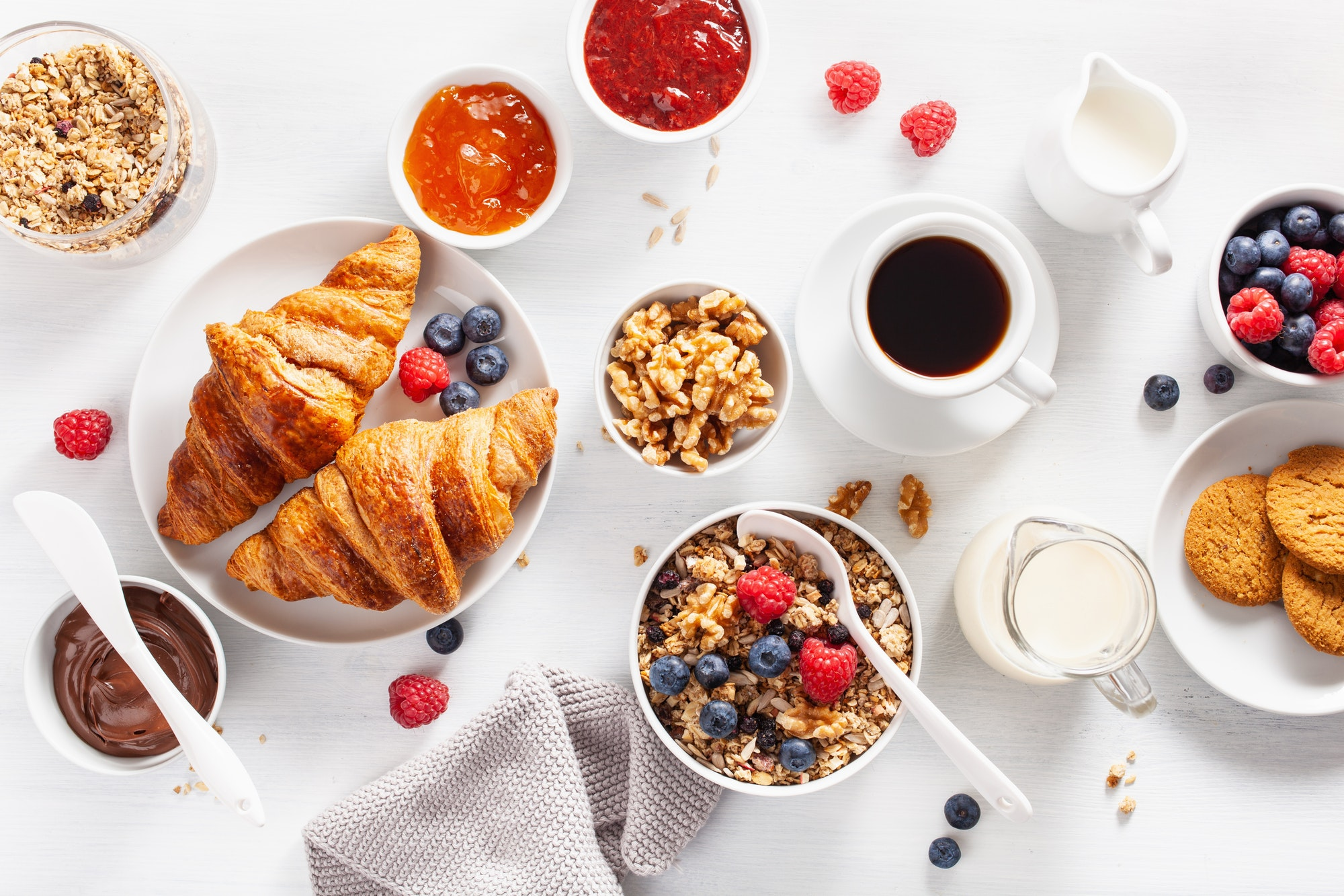 Continental breakfast with croissant, jam, chocolate spread - continental breakfasts