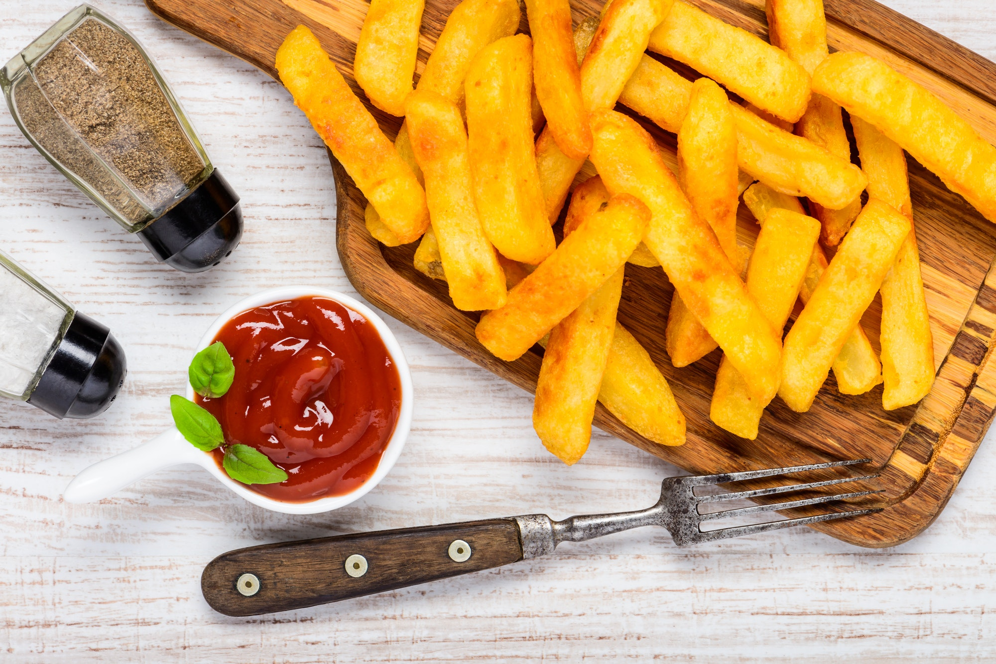 French Fries With Condiments and Ketchup