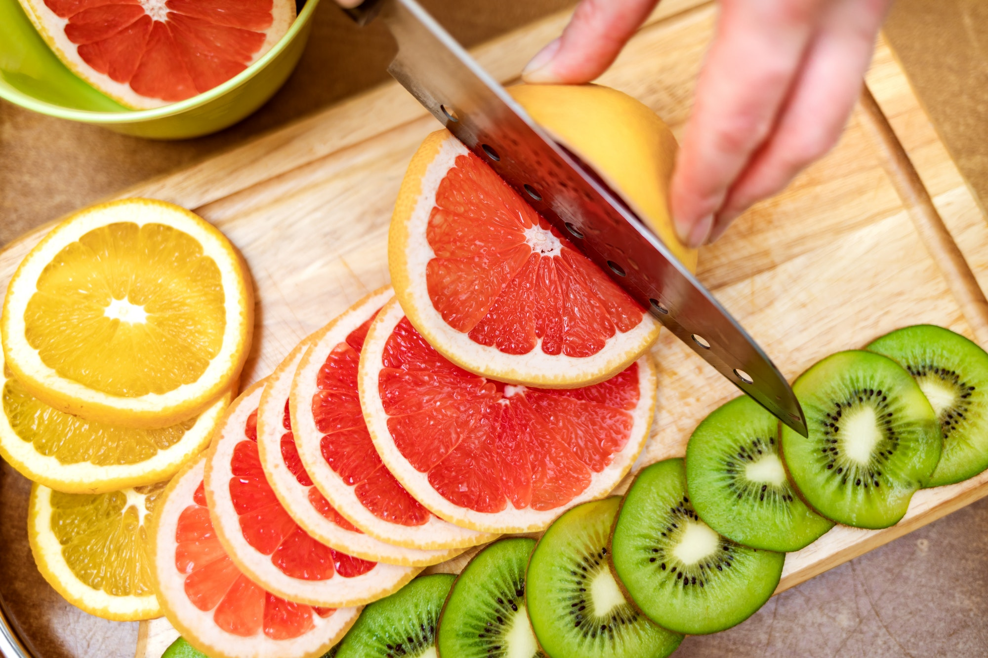 using knife to slice fruits
